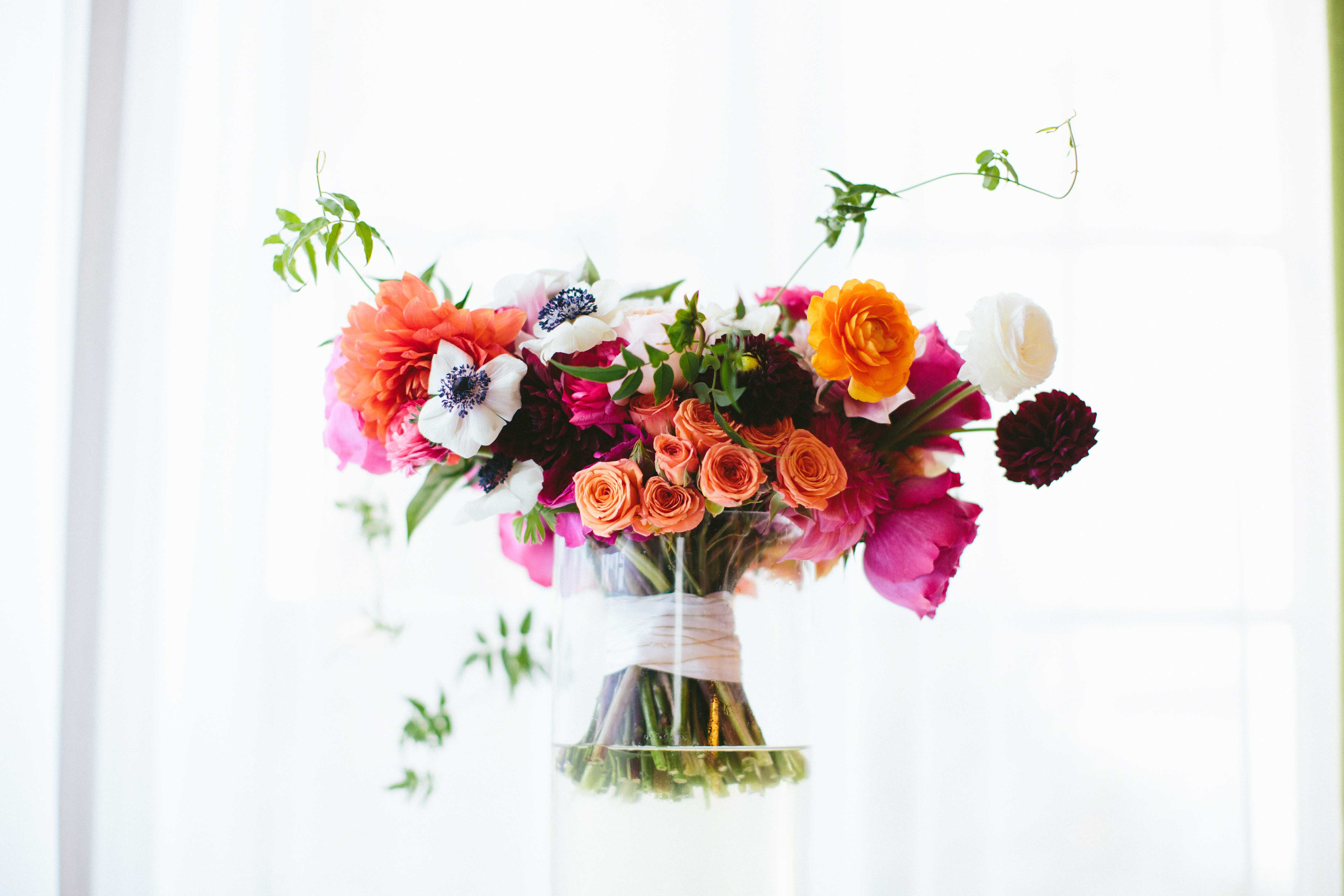 coral, maroon, white bridal bouquet with roses, peonies and dahlias