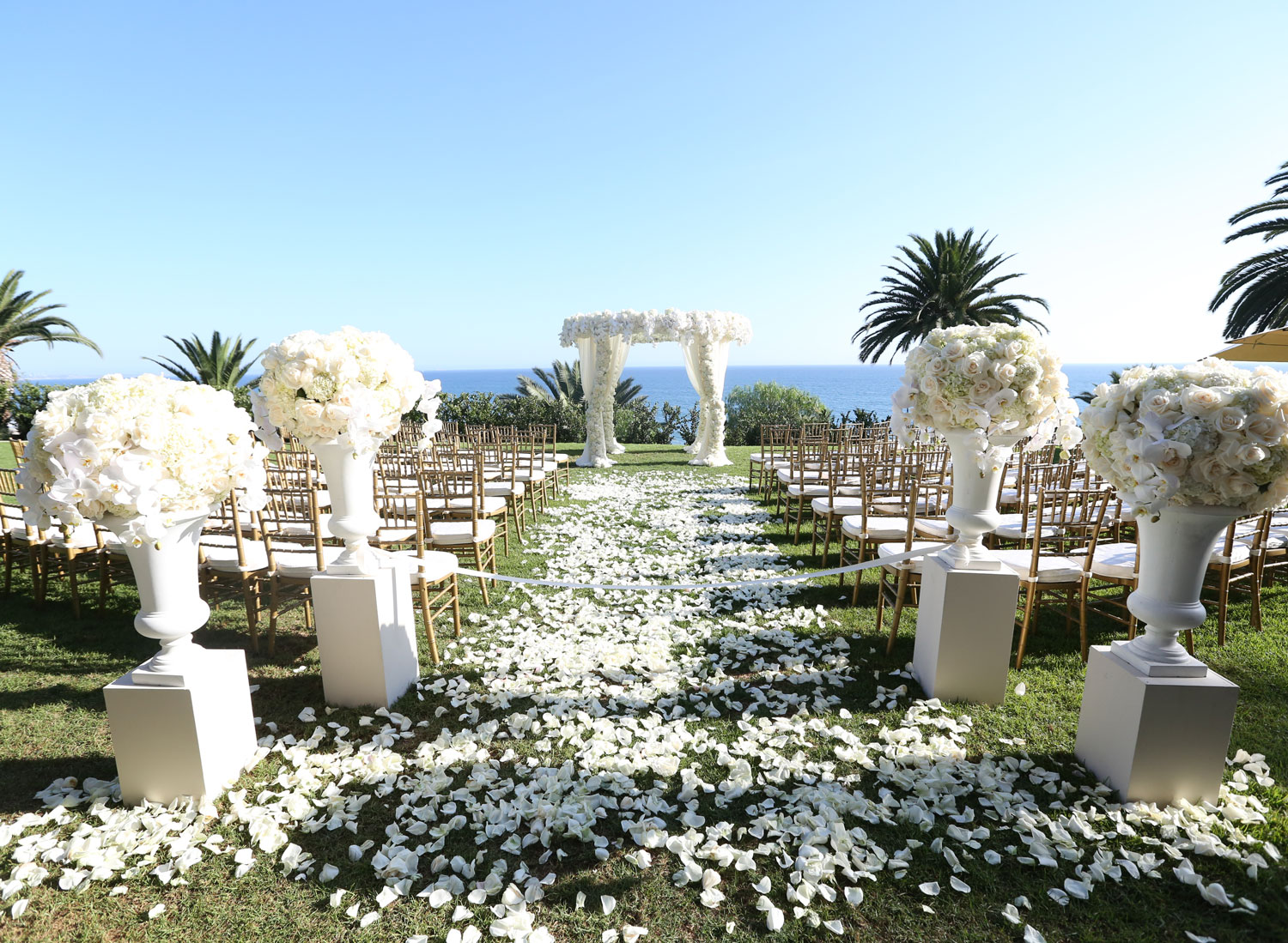 White flowers at outdoor wedding ceremony by ocean