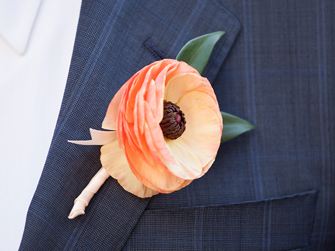 pastel wedding inspiration, soft orange-yellow ranunculus boutonniere