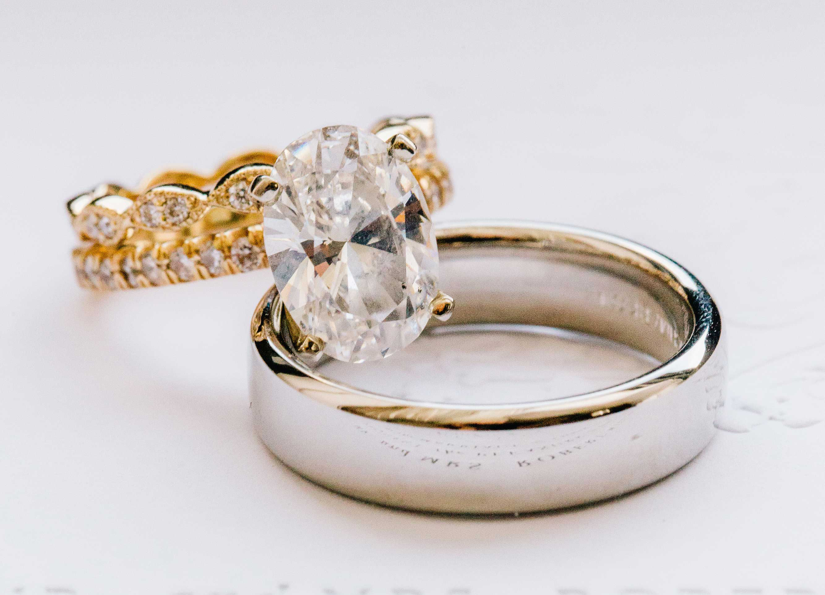 oval diamond engagement ring with pavé yellow gold band