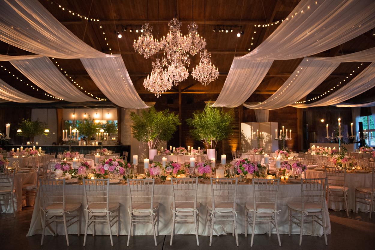 cluster of chandeliers in rustic wedding reception