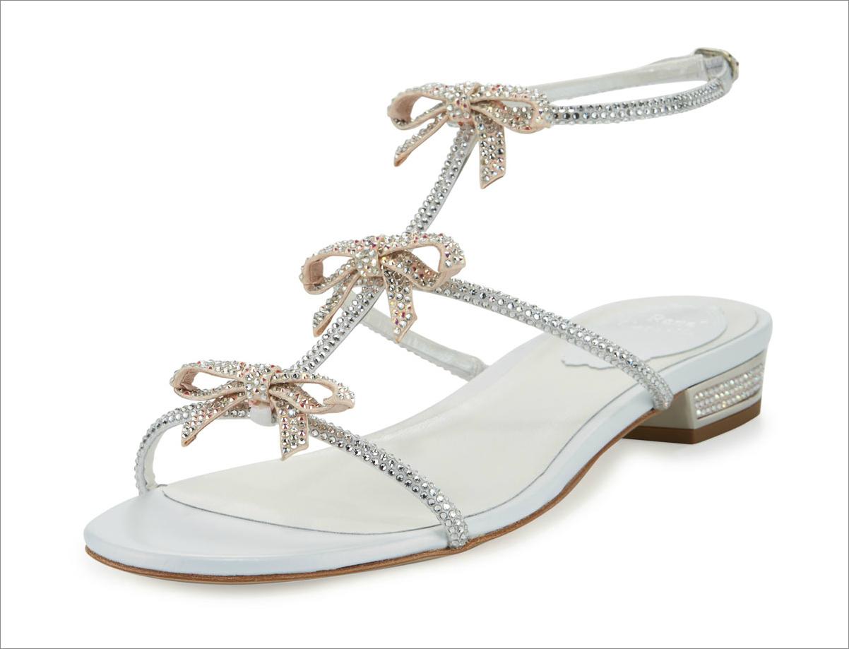 Crystal bow-embellished T-strap flat sandal, $906 by Rene Caovilla; bergdorfgoodman.com