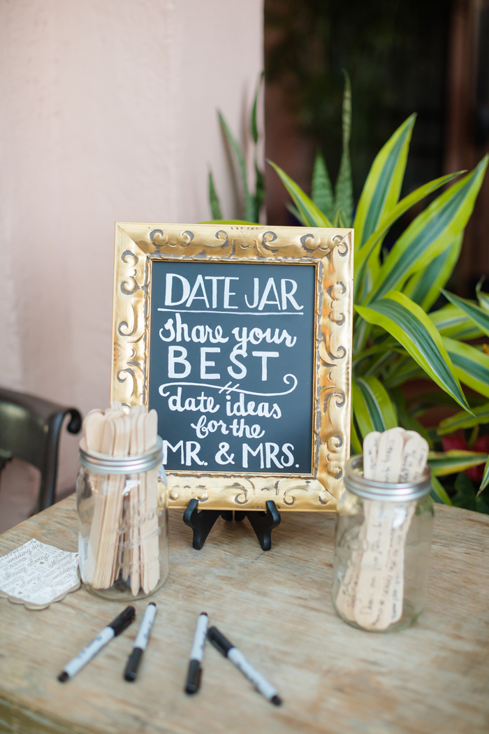 date night jar sign at wedding reception guest book