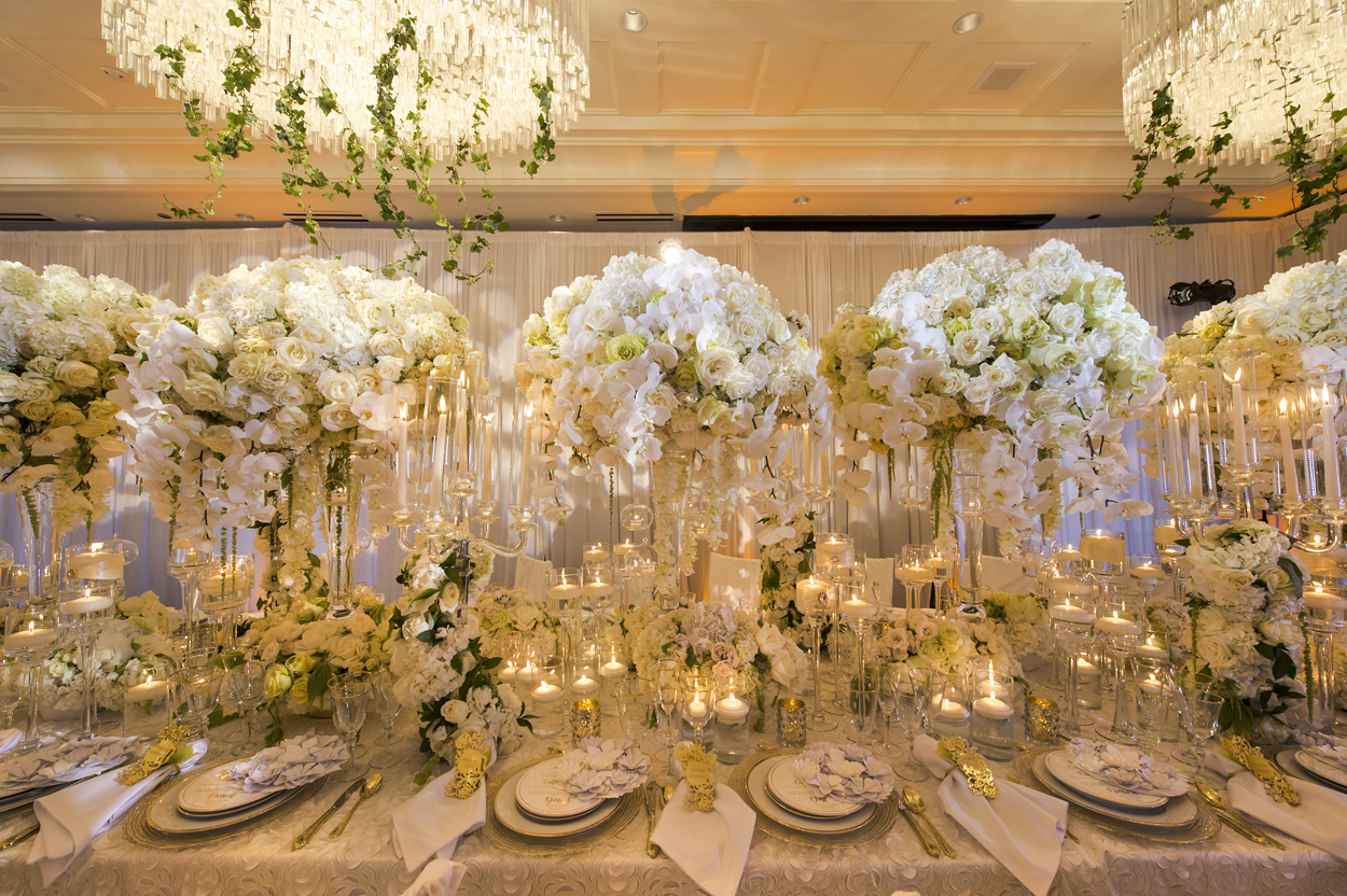 large floral centerpieces with white roses and orchids