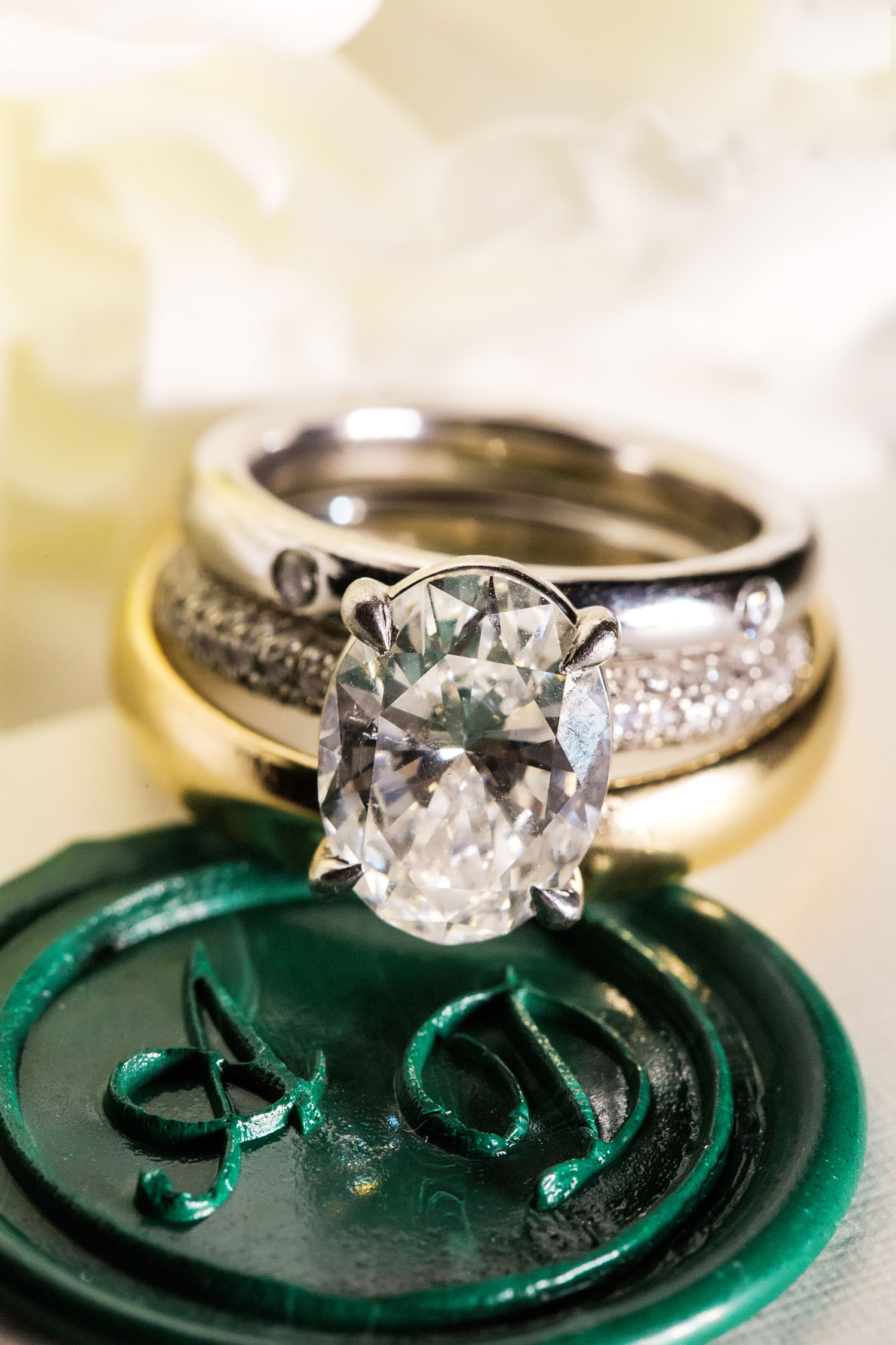 Inside Weddings Summer 2017 Issue Preview oval diamond engagement ring green wax seal