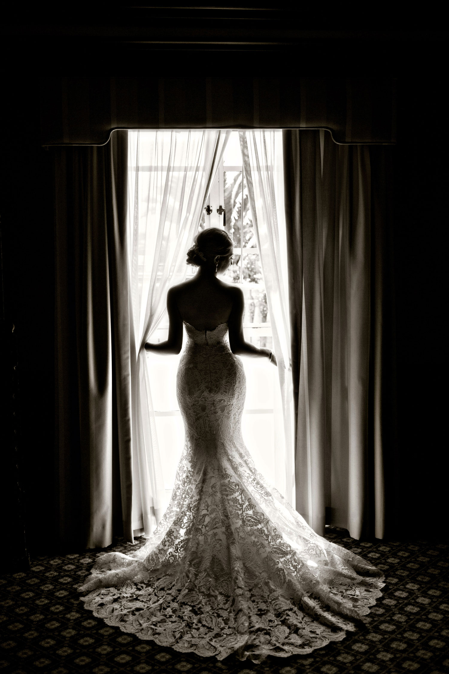 Laurie Bailey Photography black and white photo bridal portrait idea back of bride mermaid gown looking out window