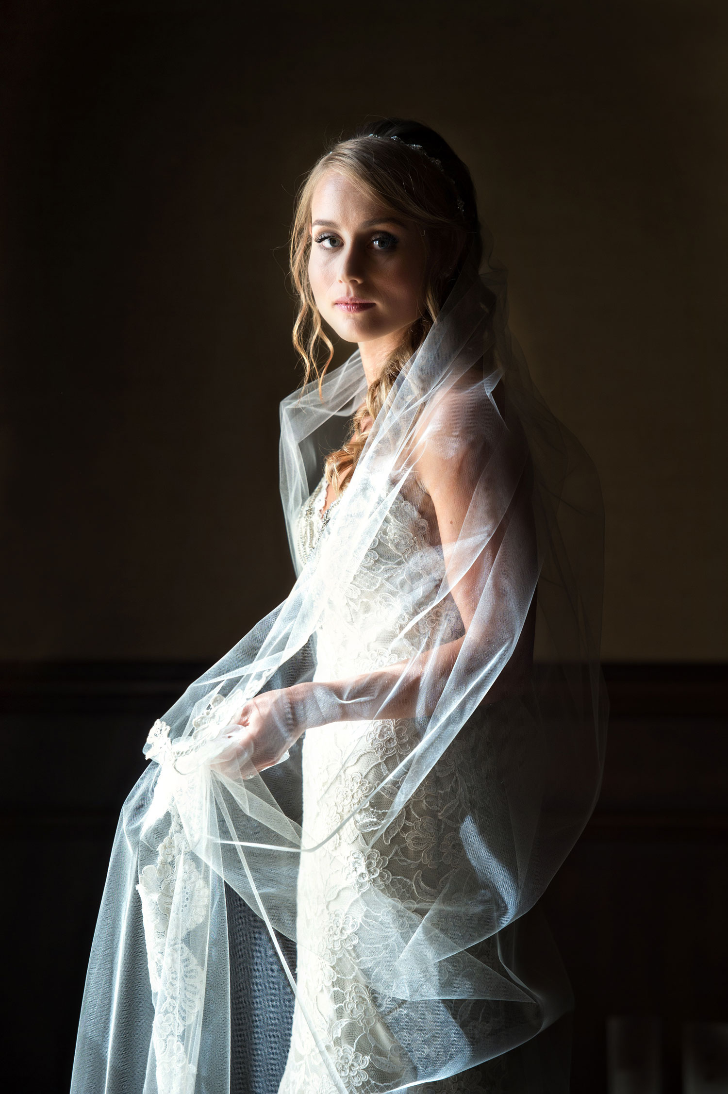 Laurie Bailey Photography bride with veil wrapped around her dark photo ideas