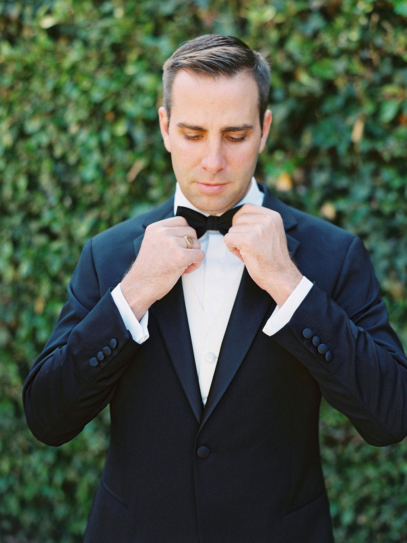 groom adjusted bow tie of classic giorgio armani tuxedo