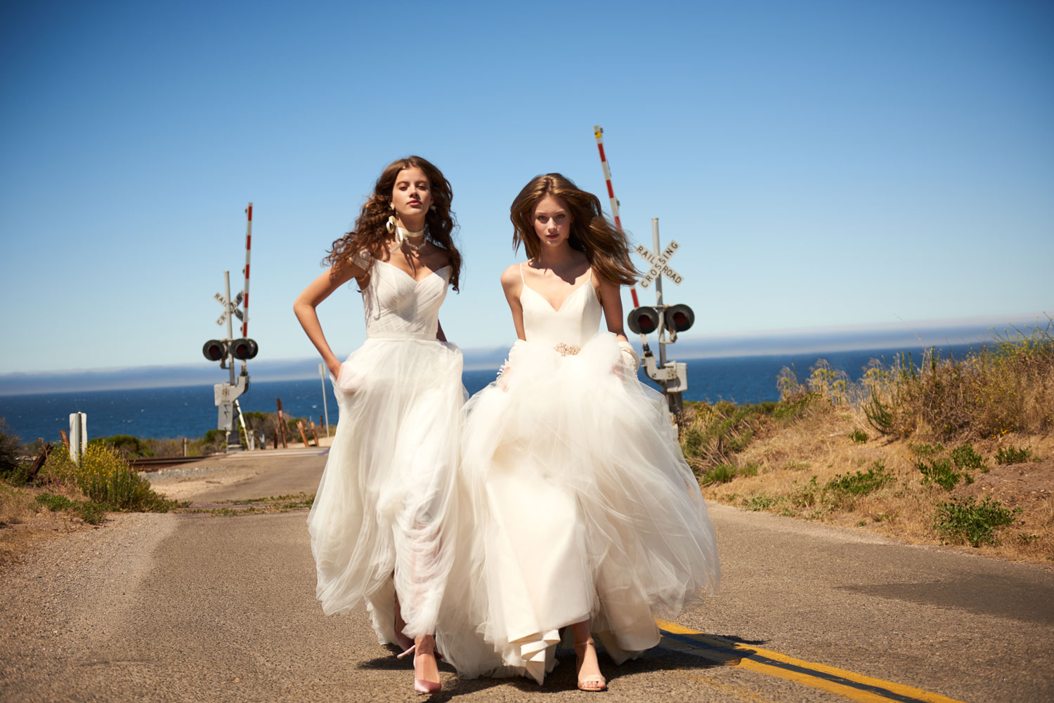 Brides in wedding dresses from bhldn americana collection buy now shop