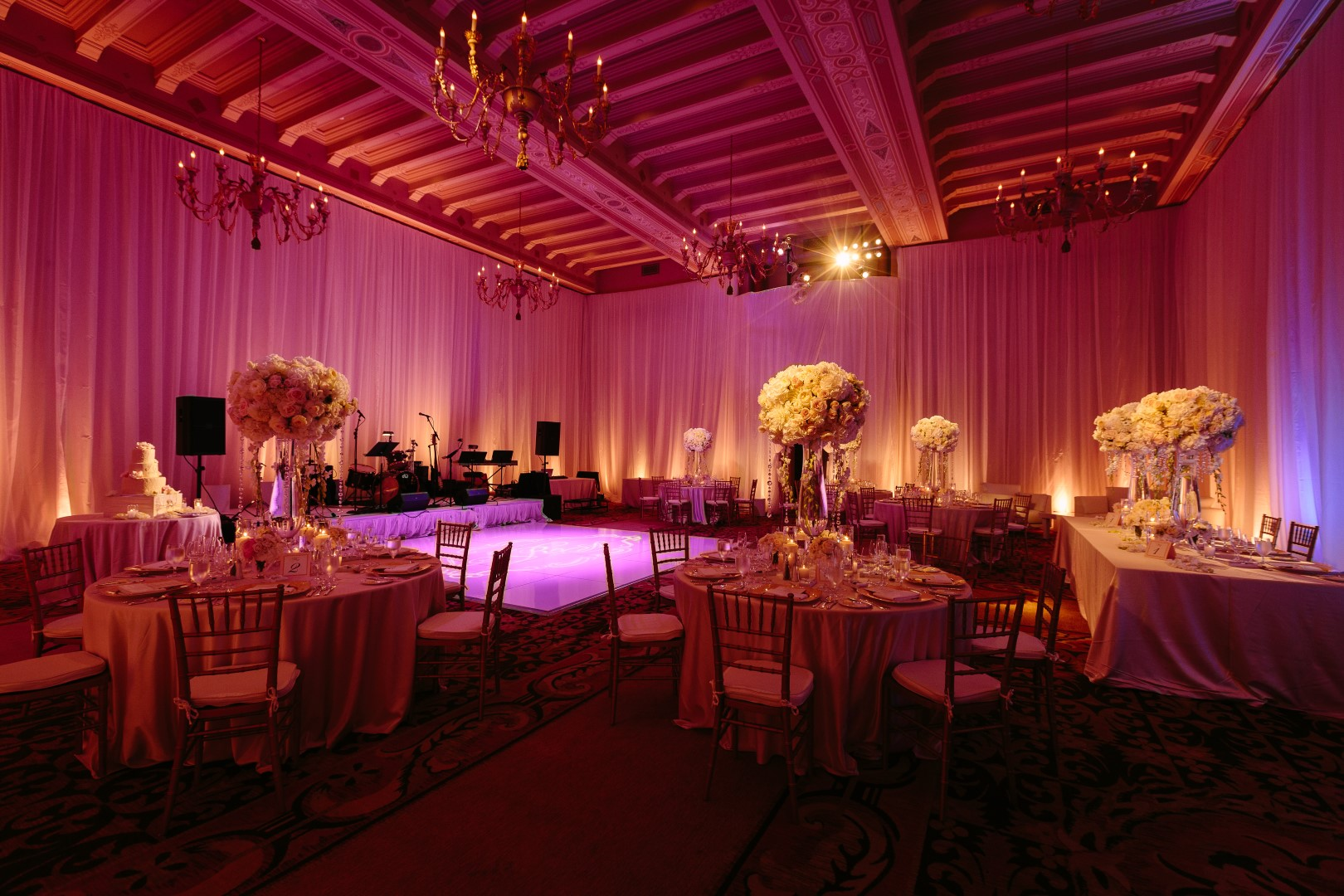 10 Wedding Reception Spaces Featuring Soft Pink Uplighting Inside