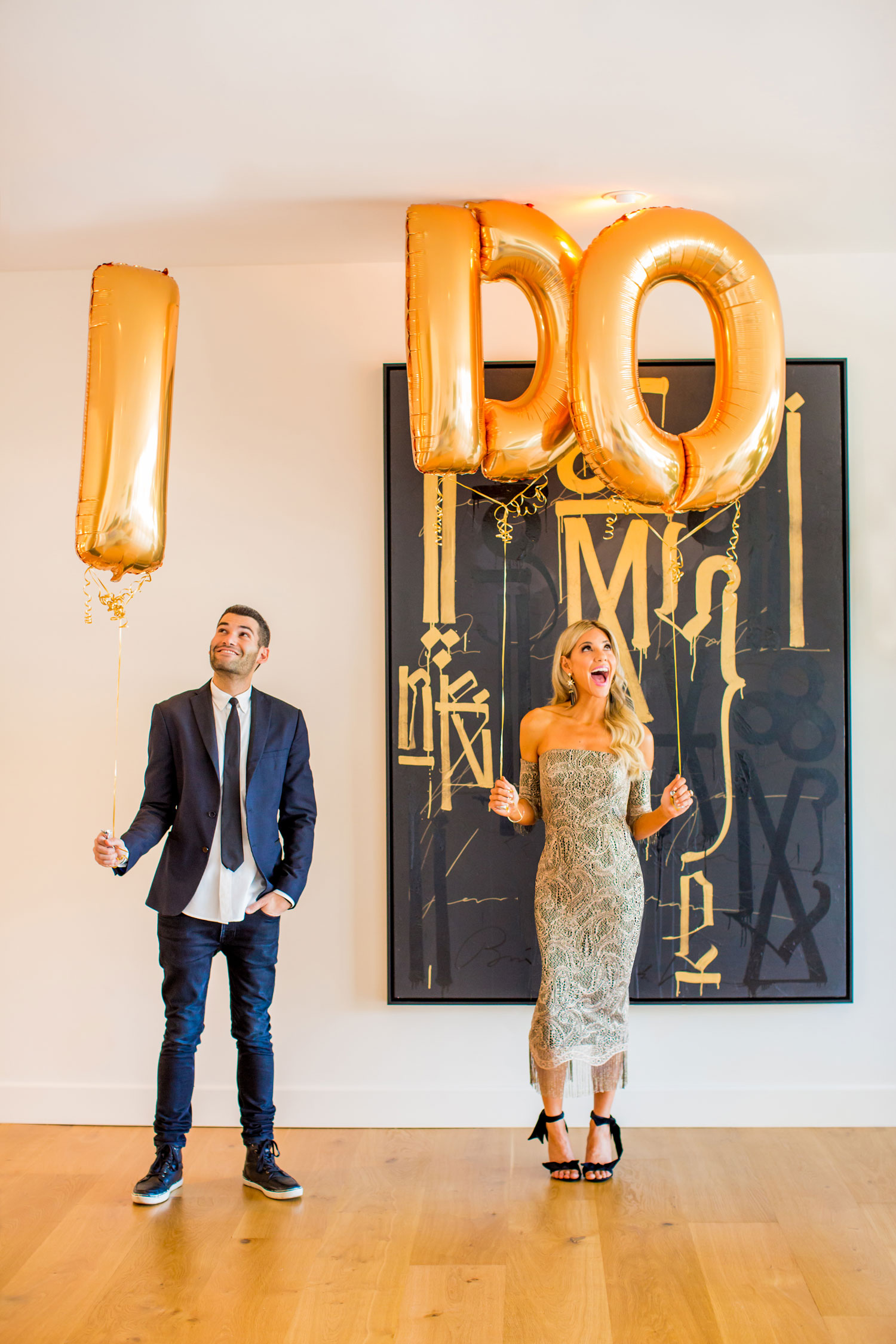 Bride and groom engaged surprise proposal with i do balloons gold