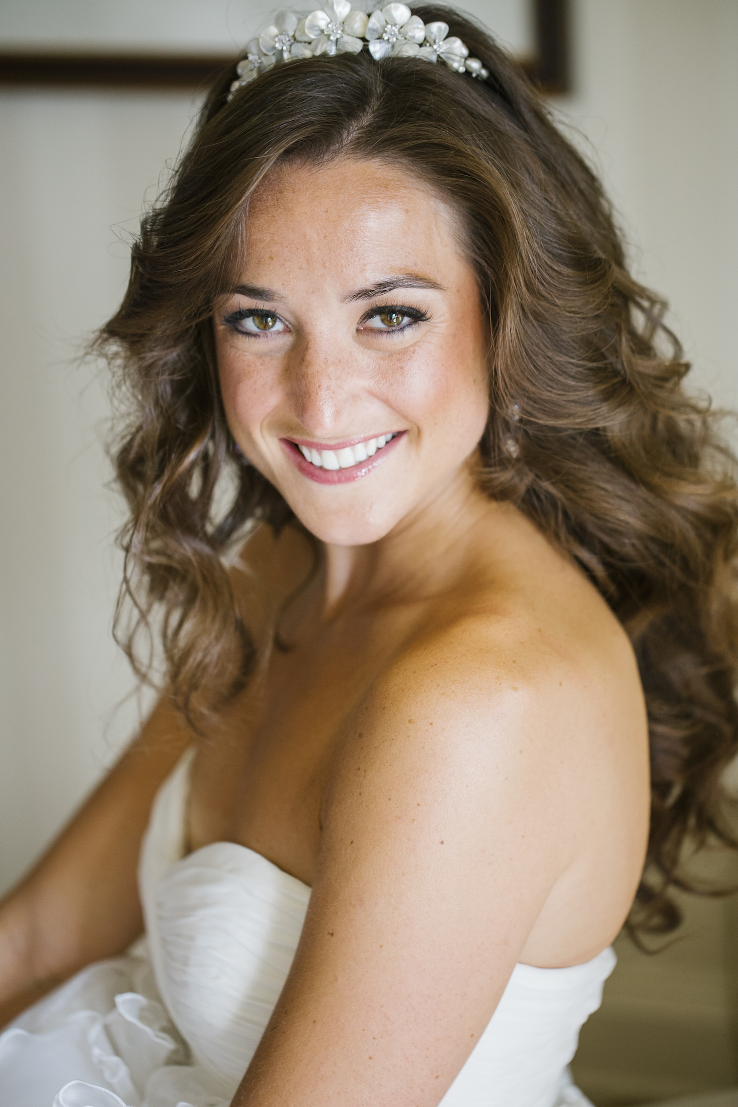 Bride with long curled brunette hair and tiara headpiece wedding ideas