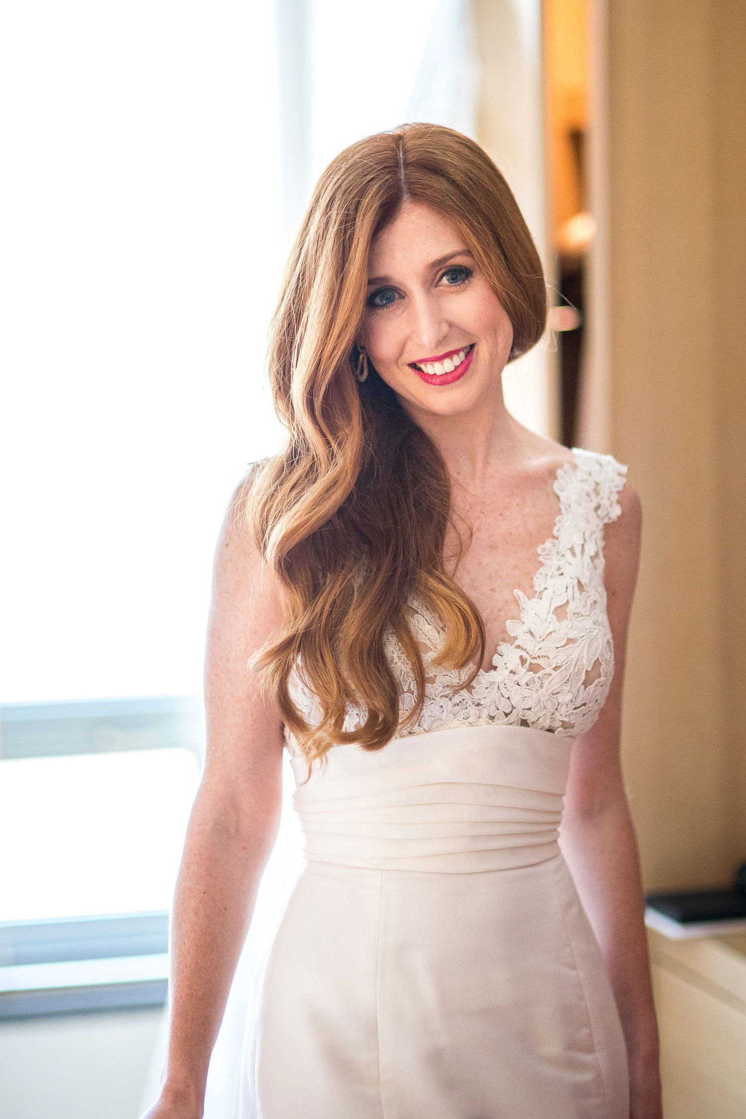 Bride with long red hair and middle part simple and sophisticated wedding hair