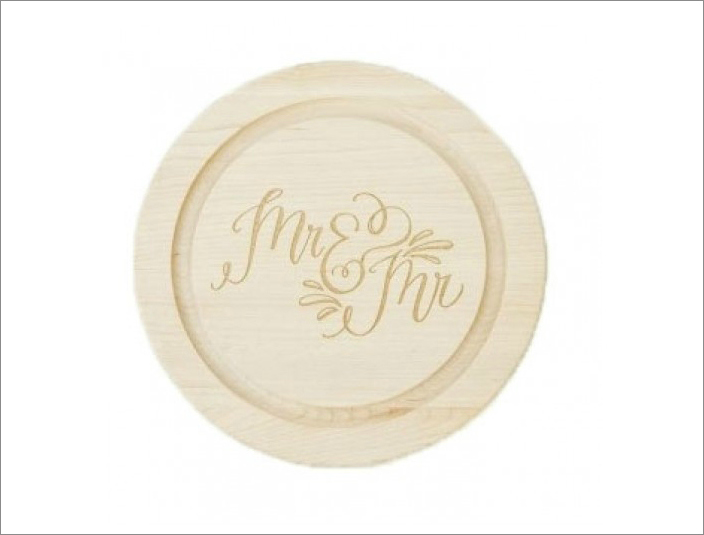 """Mr. & Mr."" round cutting board, $62 by Lindsay Letters; luluandgeorgia.com"