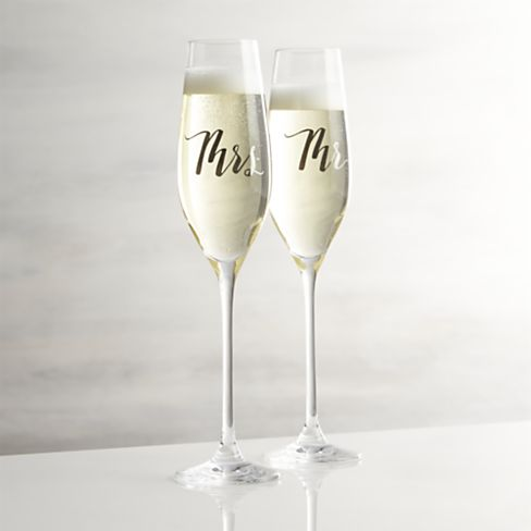 Mr. and Mrs. Champagne Glasses, $9.95/each by Crate and Barrel; crateandbarrel.com