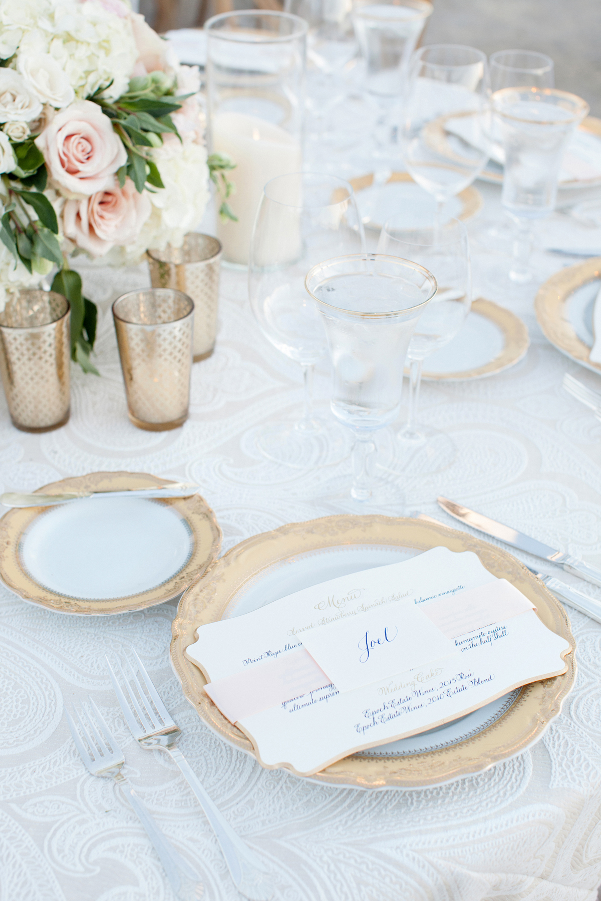 Pretty pattern neutral linens at wedding reception table white