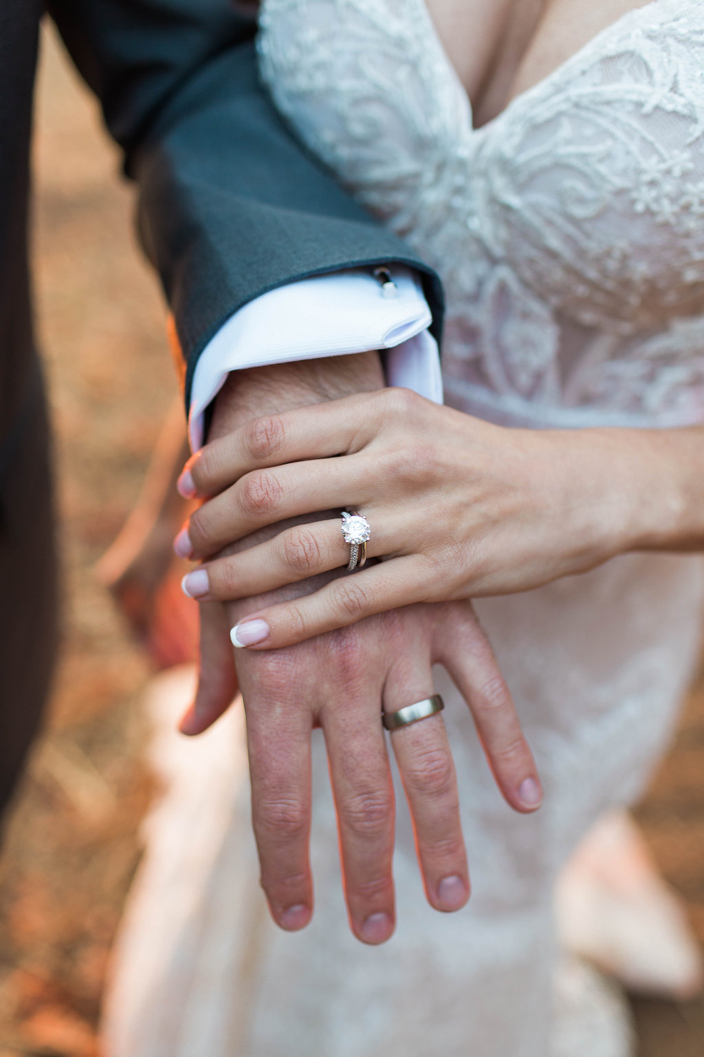 Bride holding groom's hand get the look of Keleigh Sperry's engagement ring