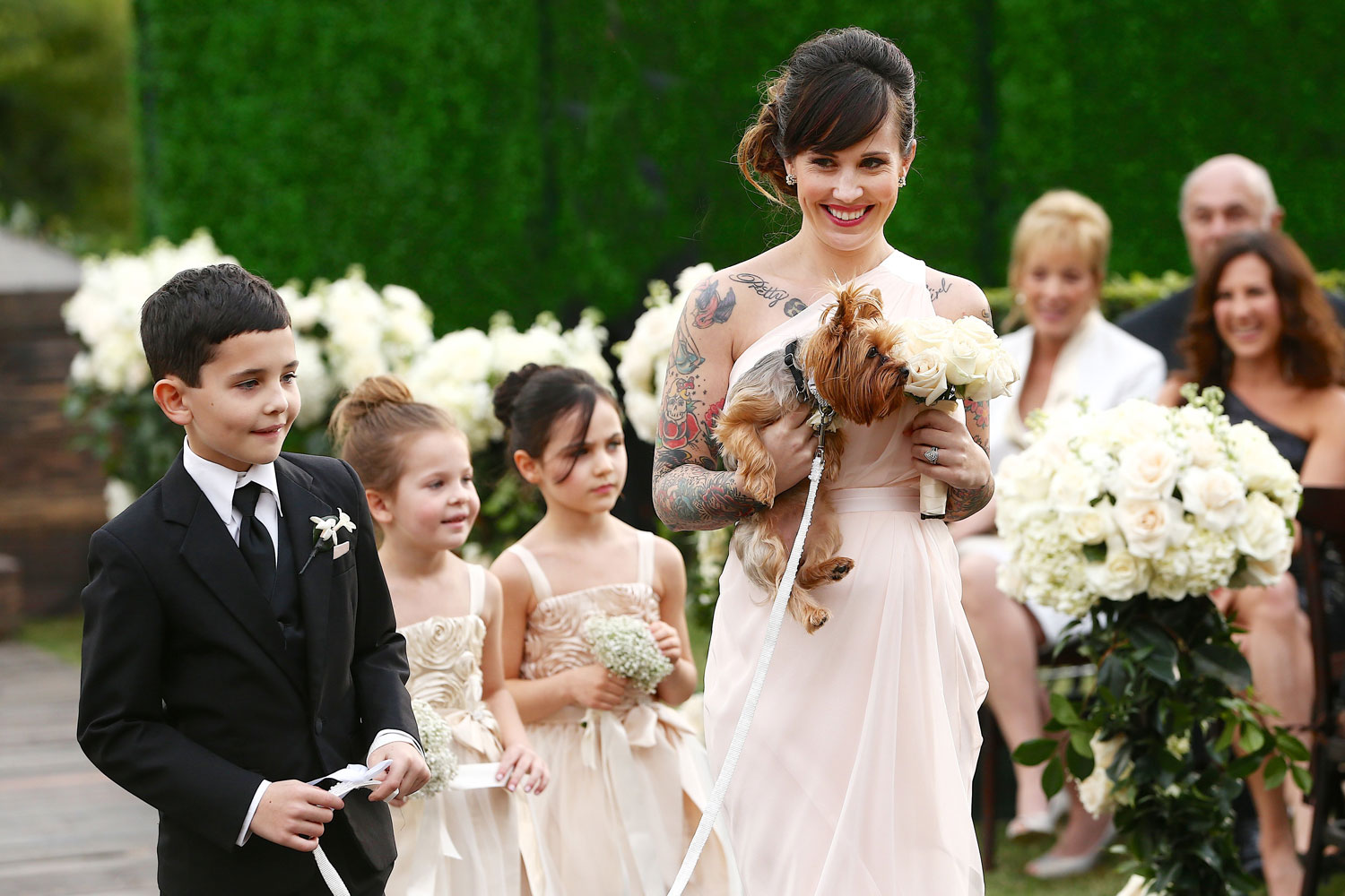 The Bachelorette Ashley Hebert wedding sister maid of honor carrying yorkie dog yorkshire terrier with flower girls ring bearers wedding