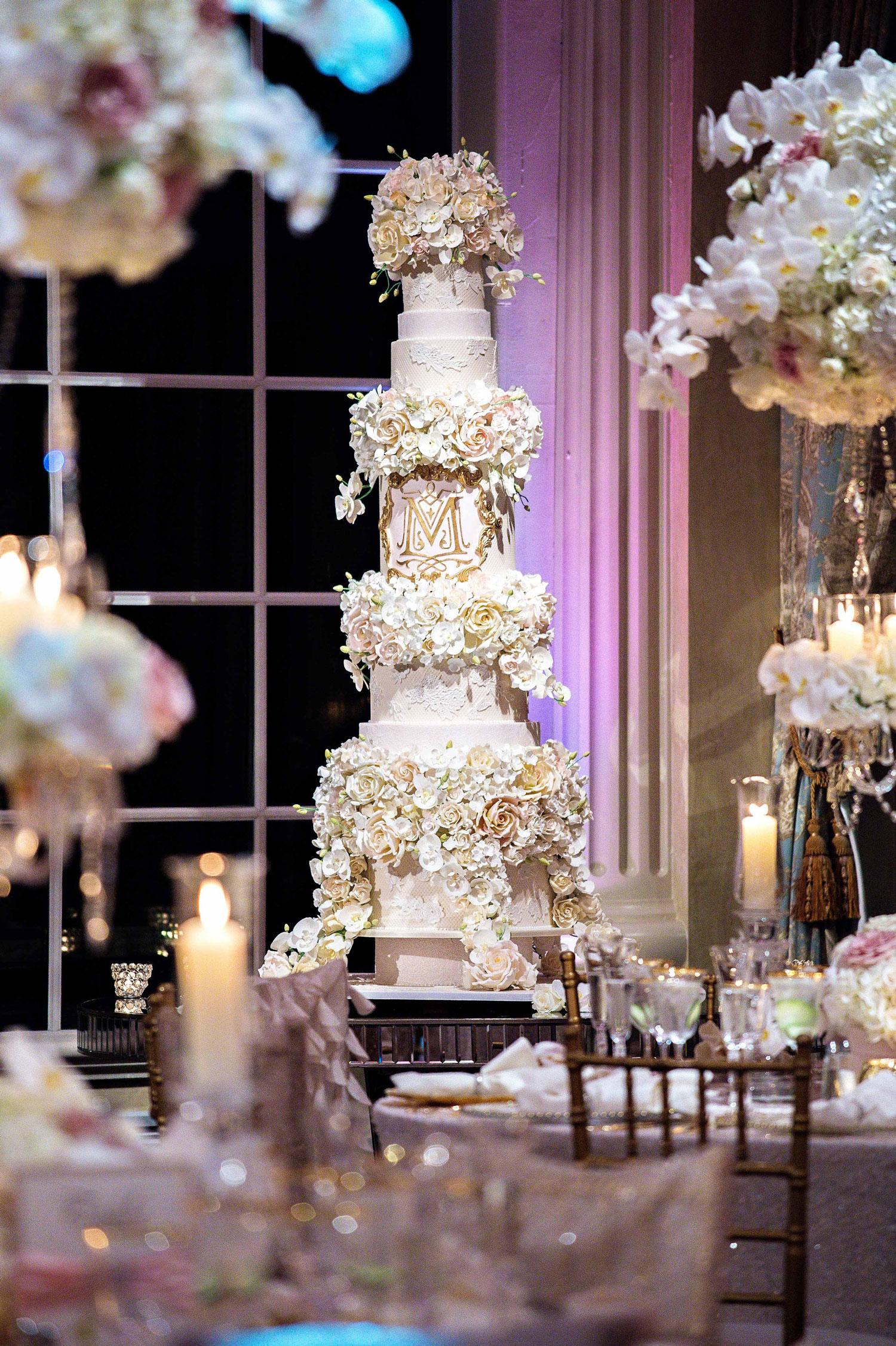 Tracy Morgan and Megan Wollover wedding cake tall opulent sugar flowers monogram