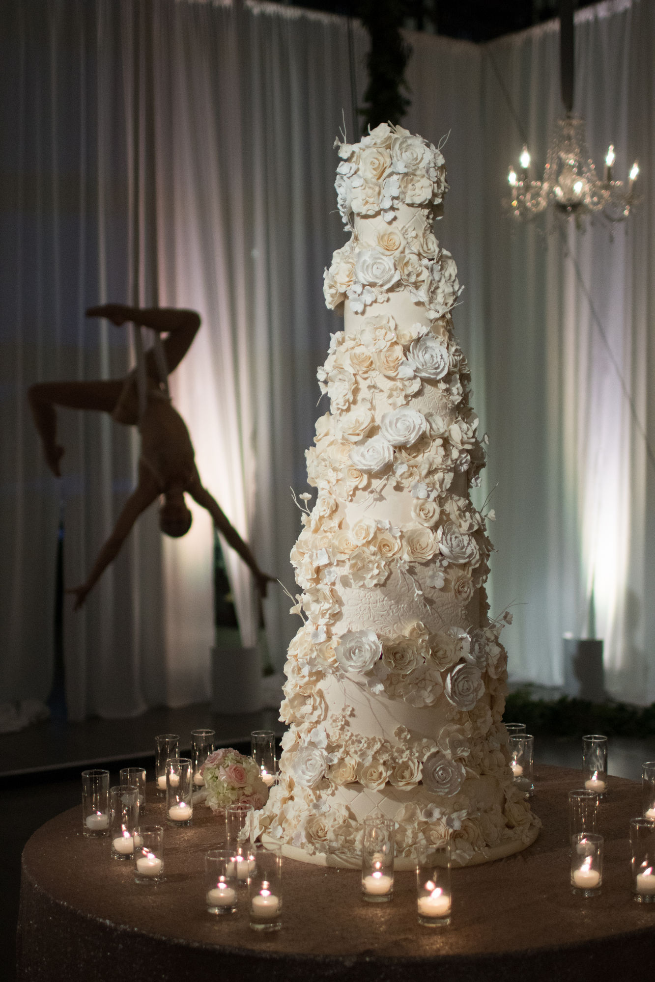 Tall opulent same sex gay wedding cake with hundreds of sugar flowers