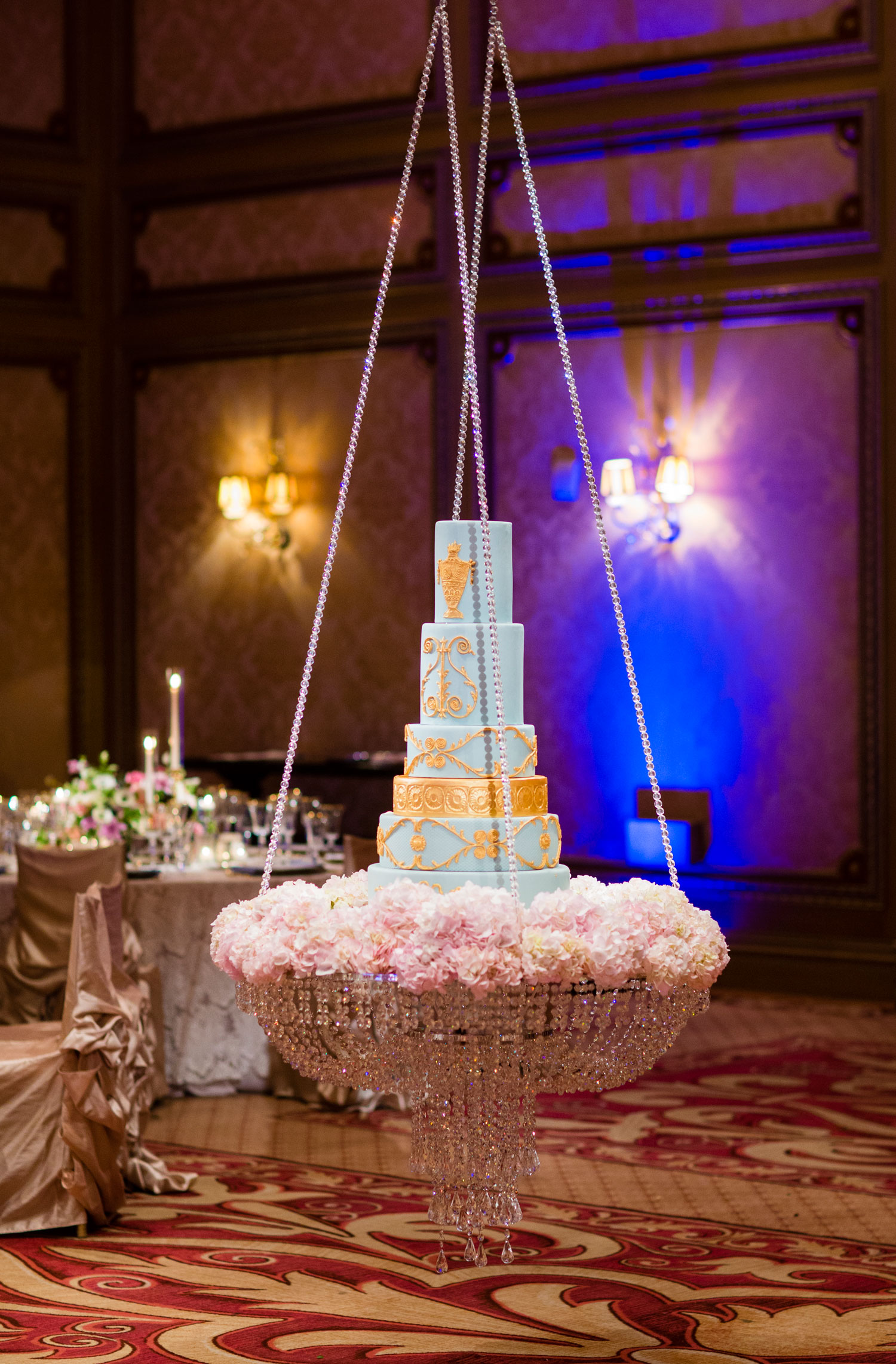 Unique light blue and gold wedding cake on swing stand flower base cake ideas