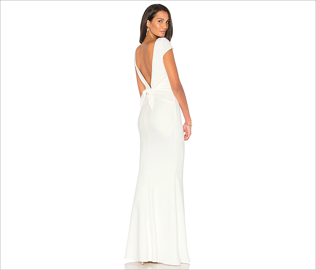 Low back rehearsal dinner outfit idea intrigue gown from Revolve by Katie May