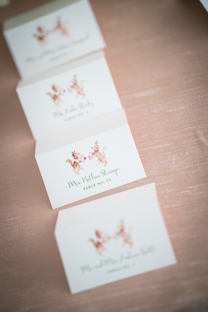 Dog drawings on escort cards at wedding