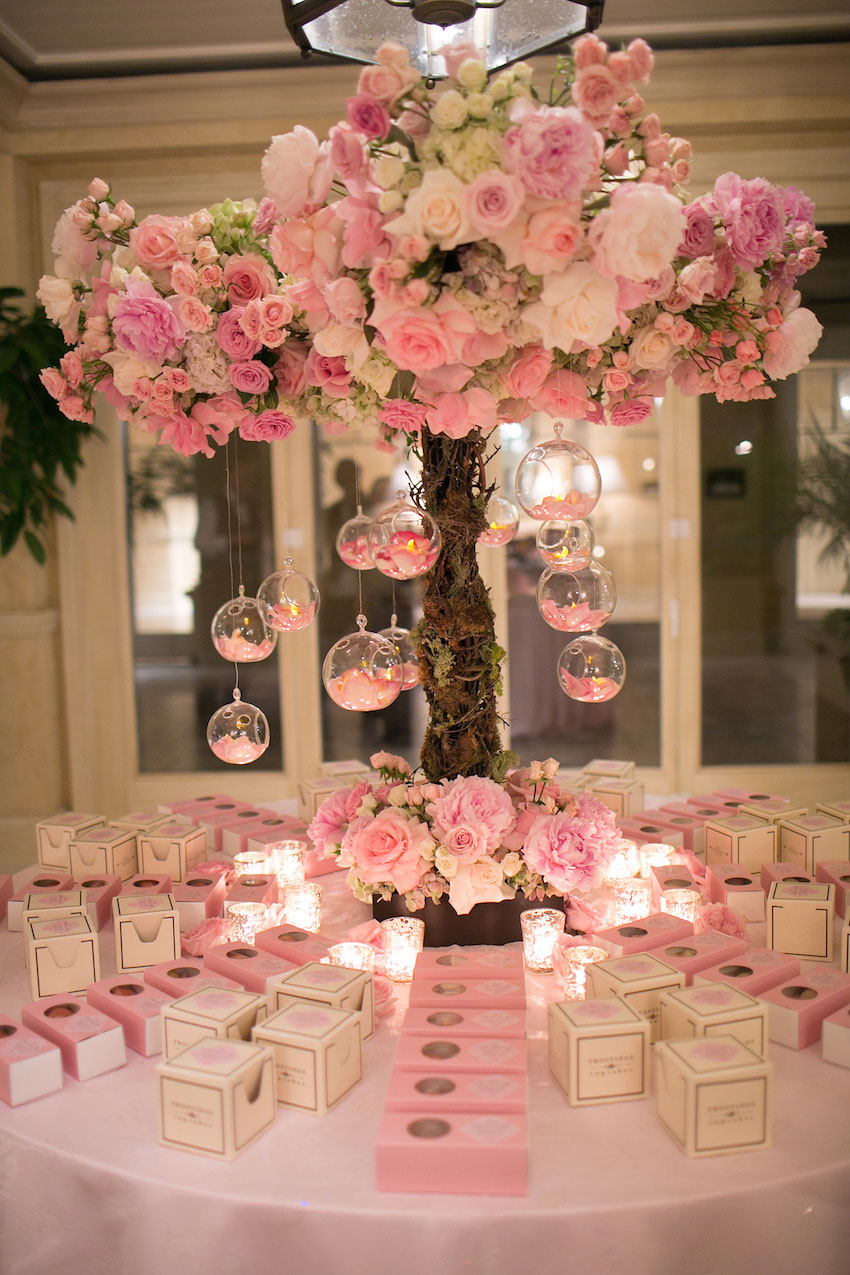 Tree branch escort card flower arrangement with pink peony flowers