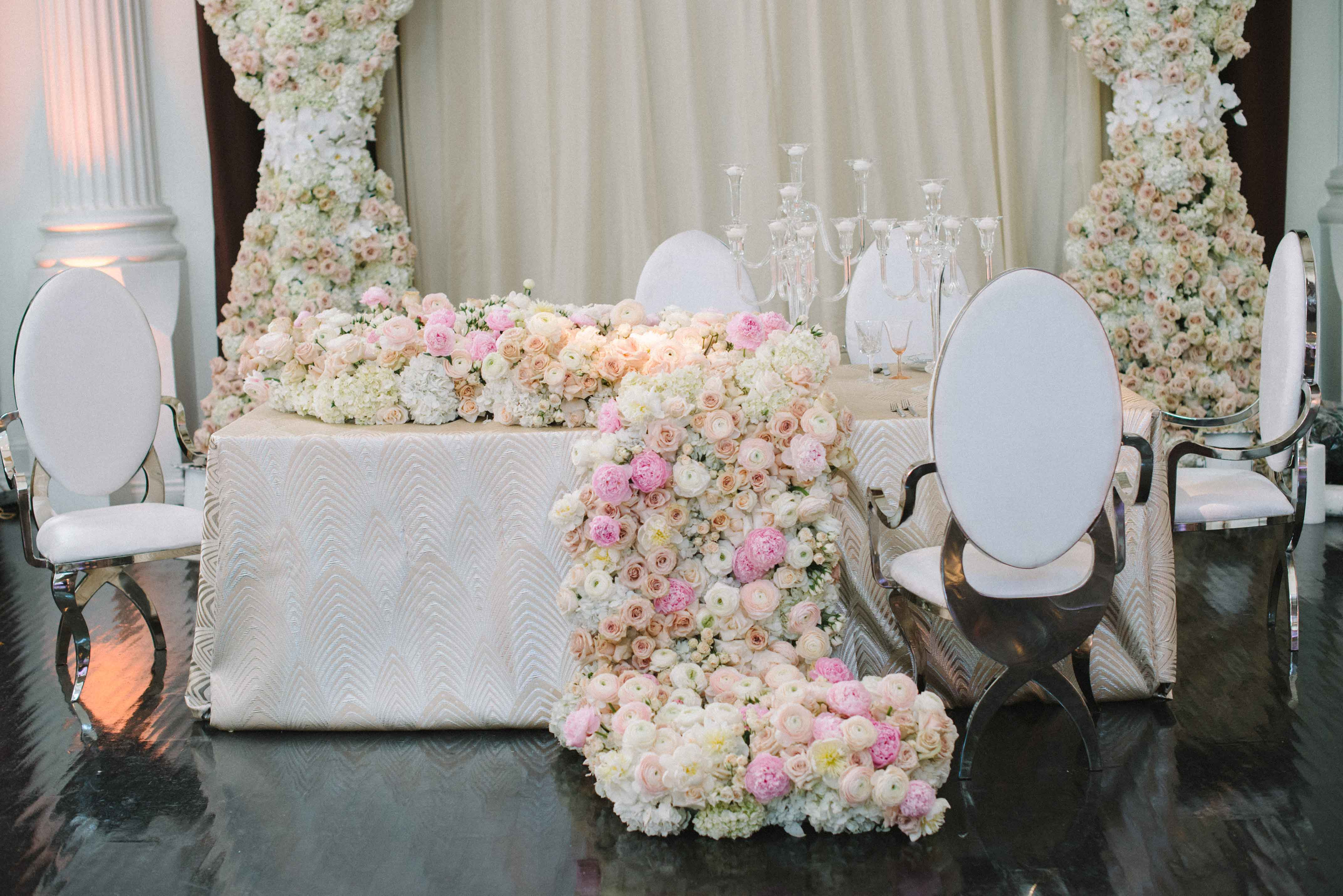 Cascading flower arrangement with peonies reception table inspiration