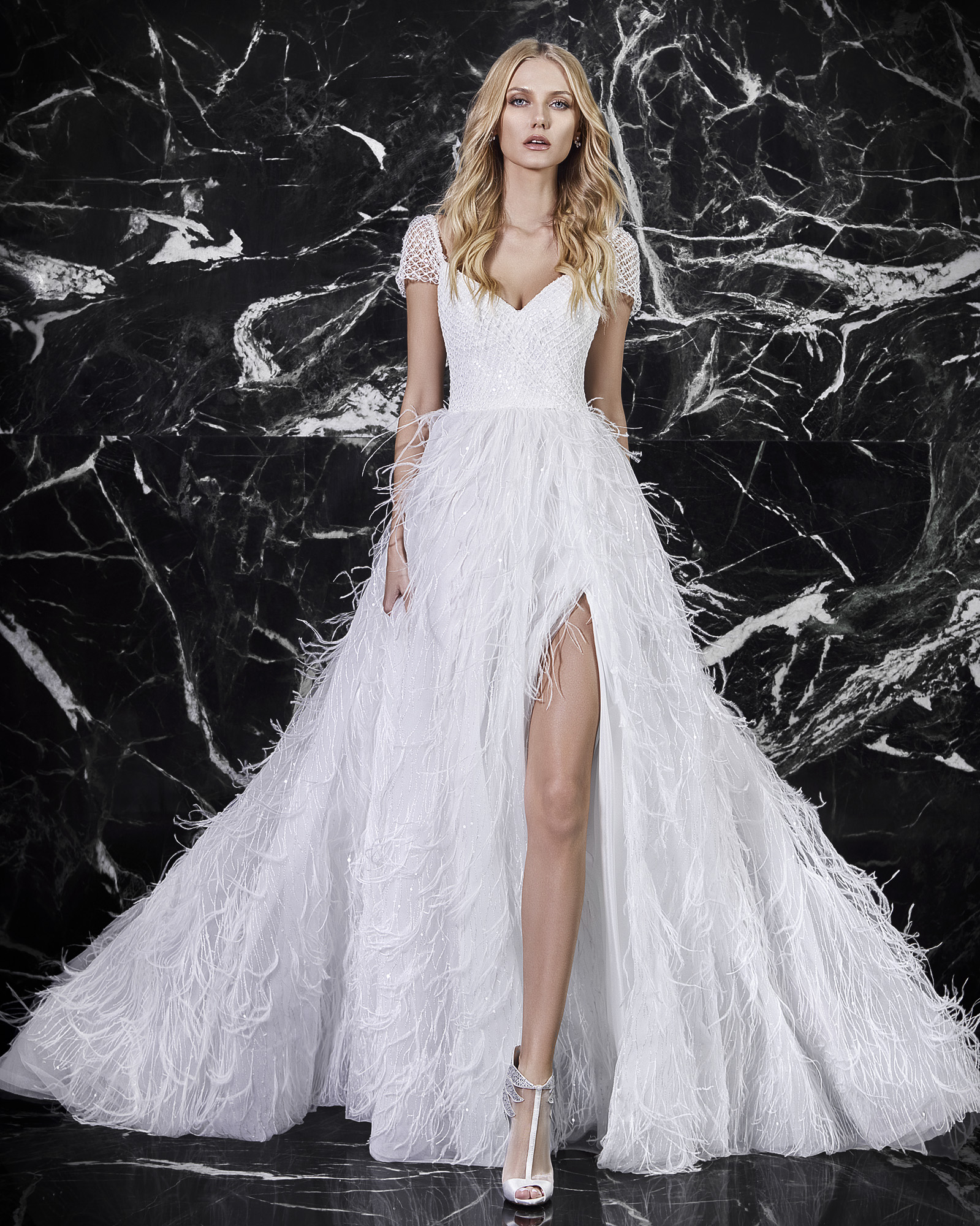 Victoria kyriakides wedding dress feathers
