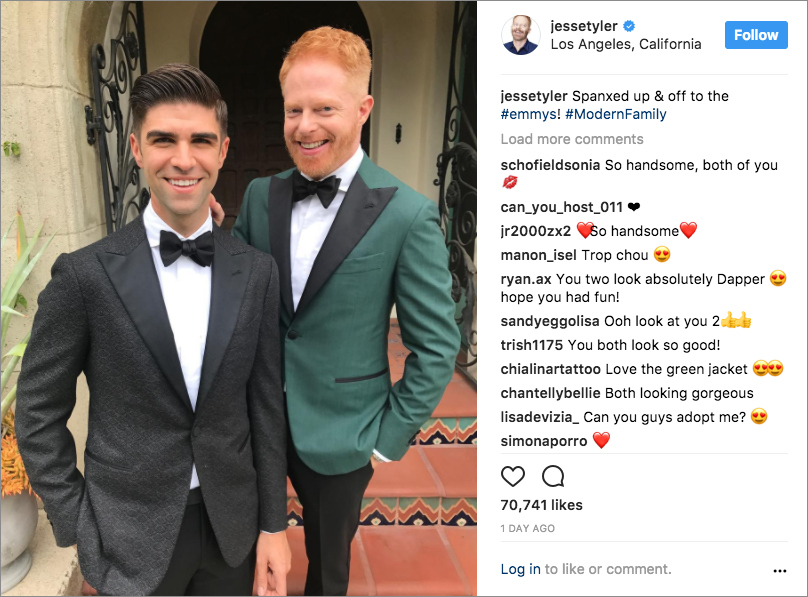 jesse tyler ferguson in green jacket with husband Justin Mikita 2017 emmy awards