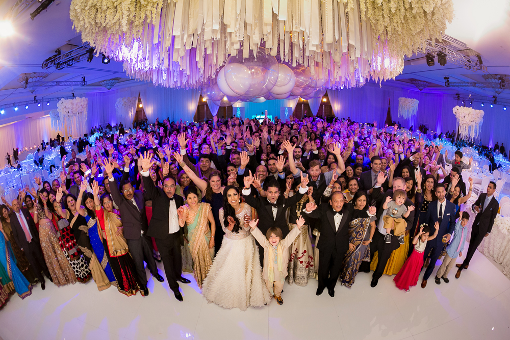 group shot of all wedding guests at indian wedding