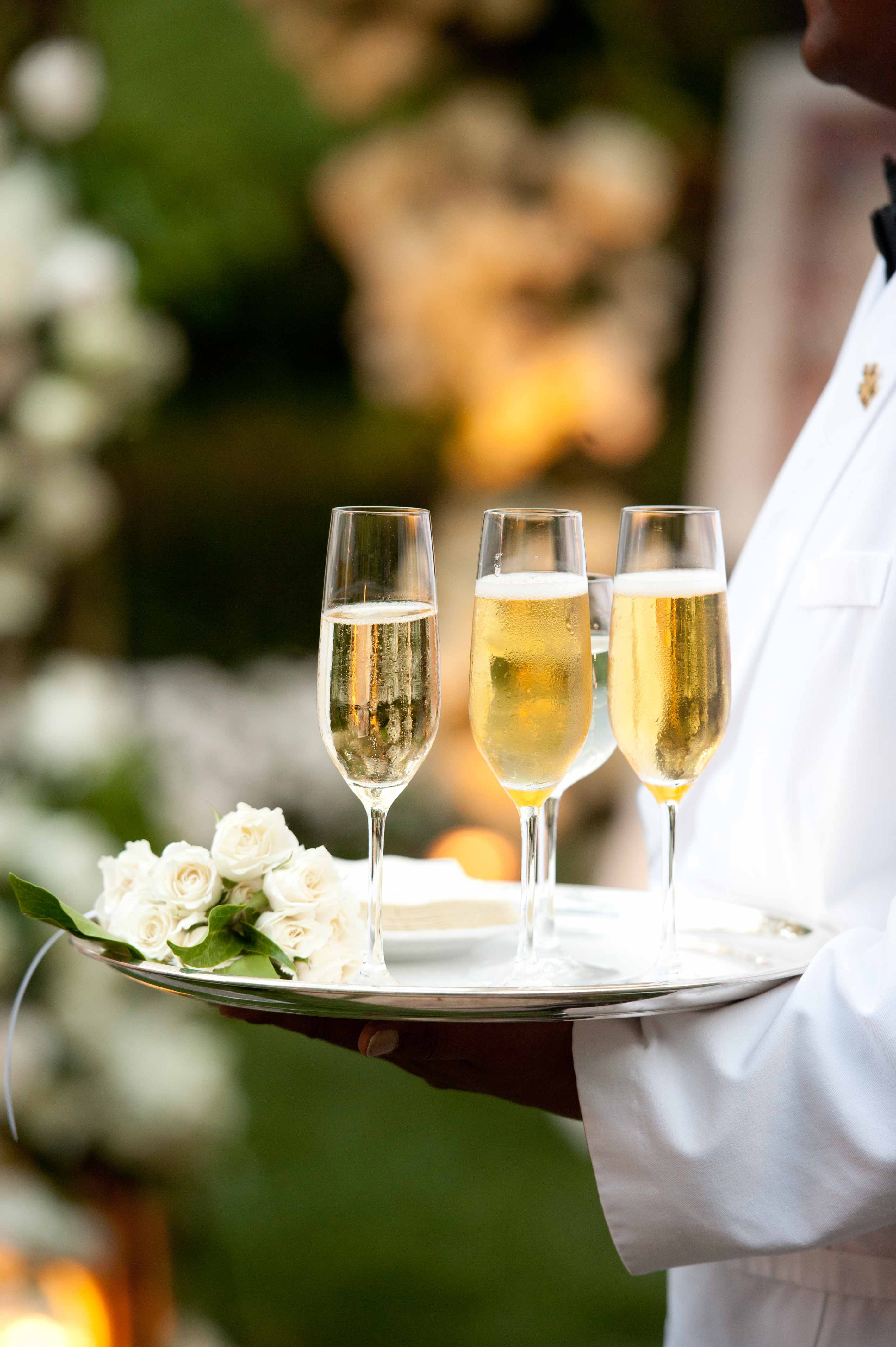 Champagne on silver platter at wedding ceremony pre wedding drinks