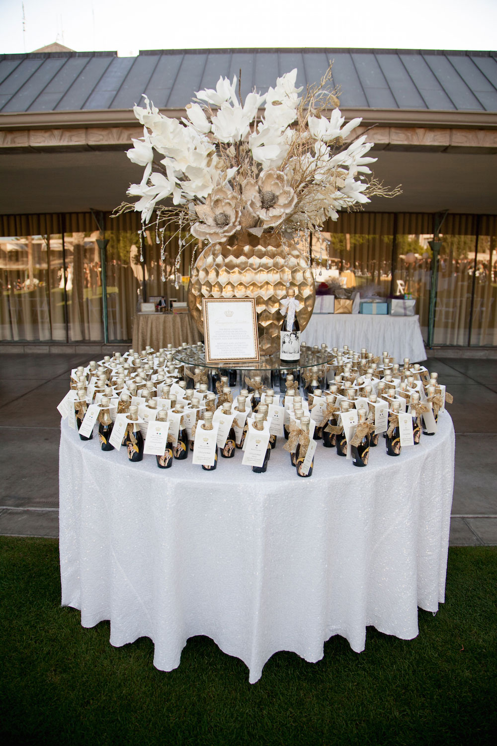 Miniature bottles of champagne for wedding favors