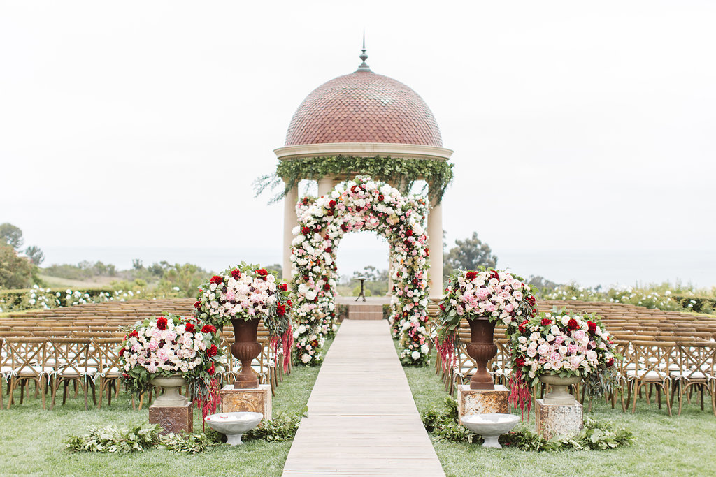 Resort at Pelican Hill wedding ceremony with fall wedding flowers