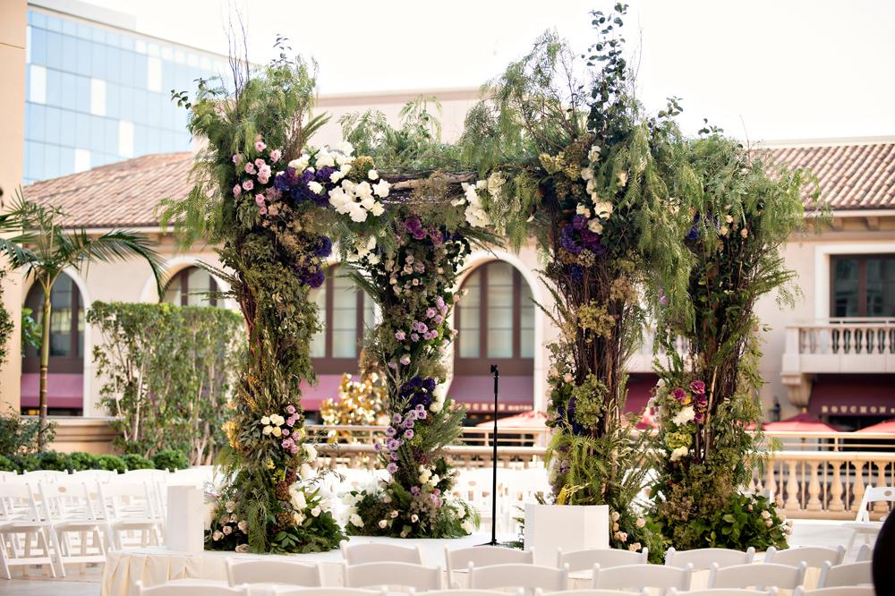 Fall wedding colors greenery and dark plum wedding flower chuppah ceremony ideas