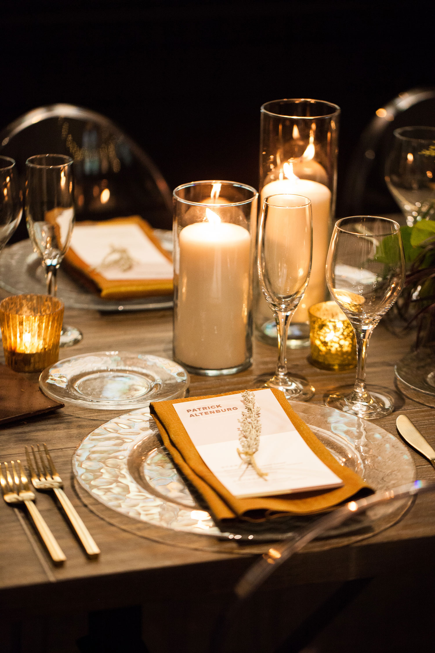 Table setting at wedding reception candlelight