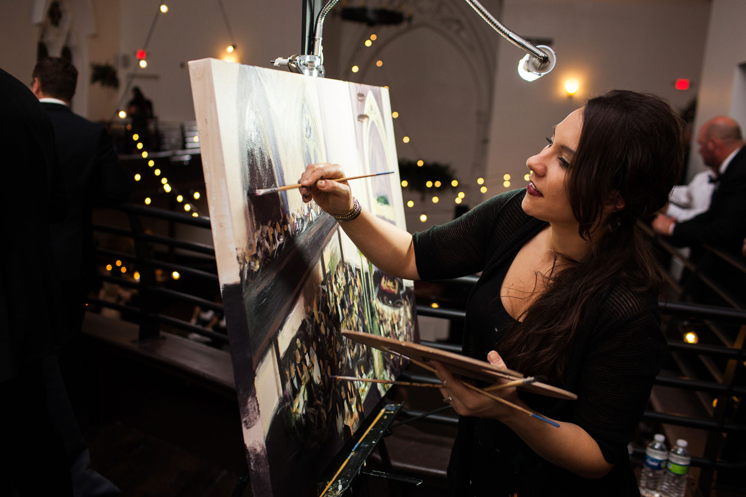 Live event painter at unique wedding reception