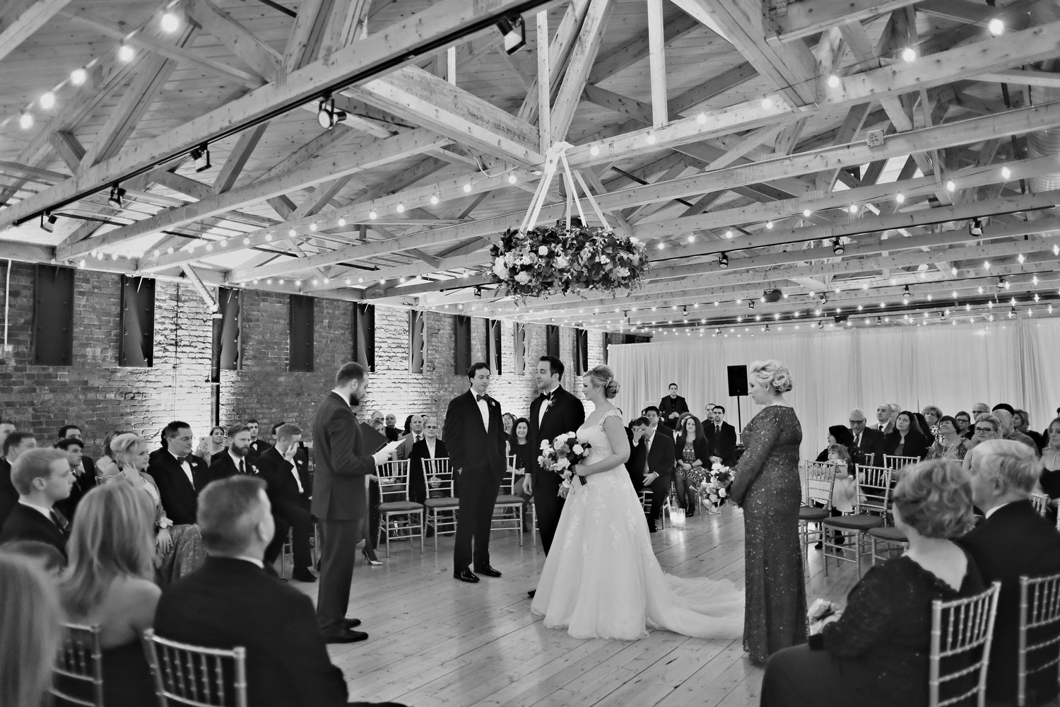 Black and white photo of wedding ceremony at brewery