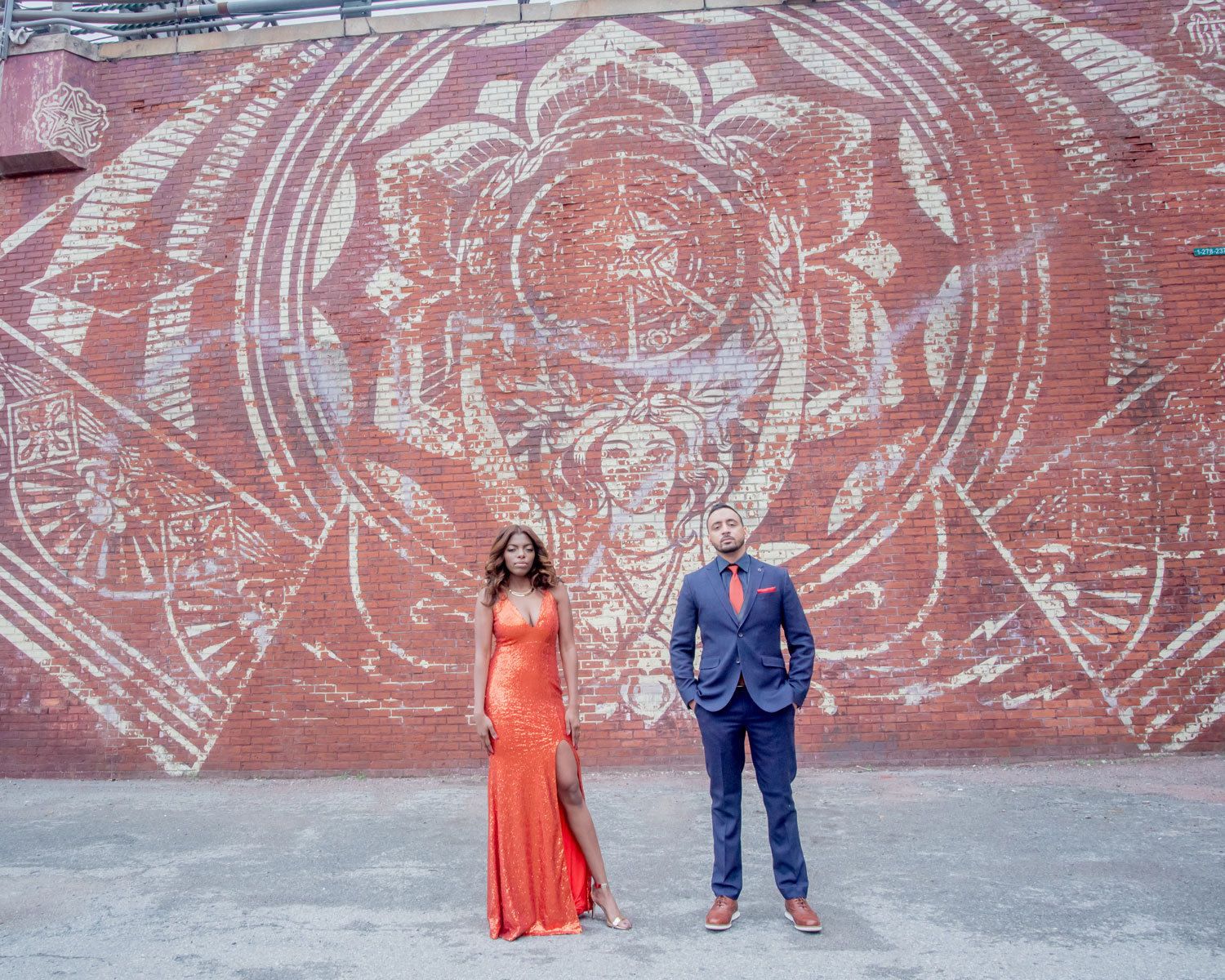 The Dumbo neighborhood Brooklyn new york engagement shoot in front of wall mural