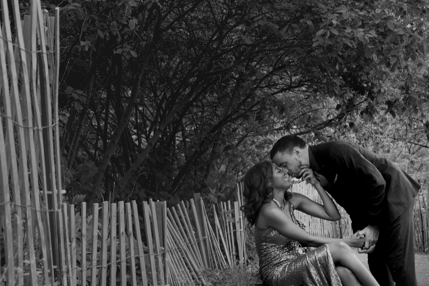 The Dumbo neighborhood Brooklyn new york engagement shoot black and white kiss on bench