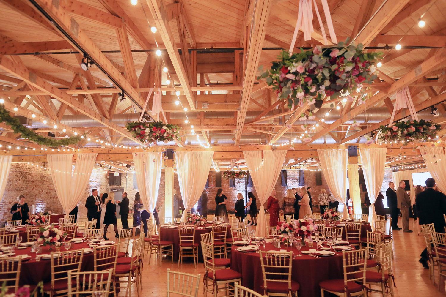 Wedding reception with dark color palette at brewery
