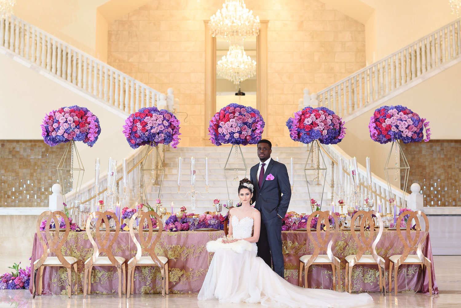 Styled shoot with bright purple color palette storybook setting Lily V Events table