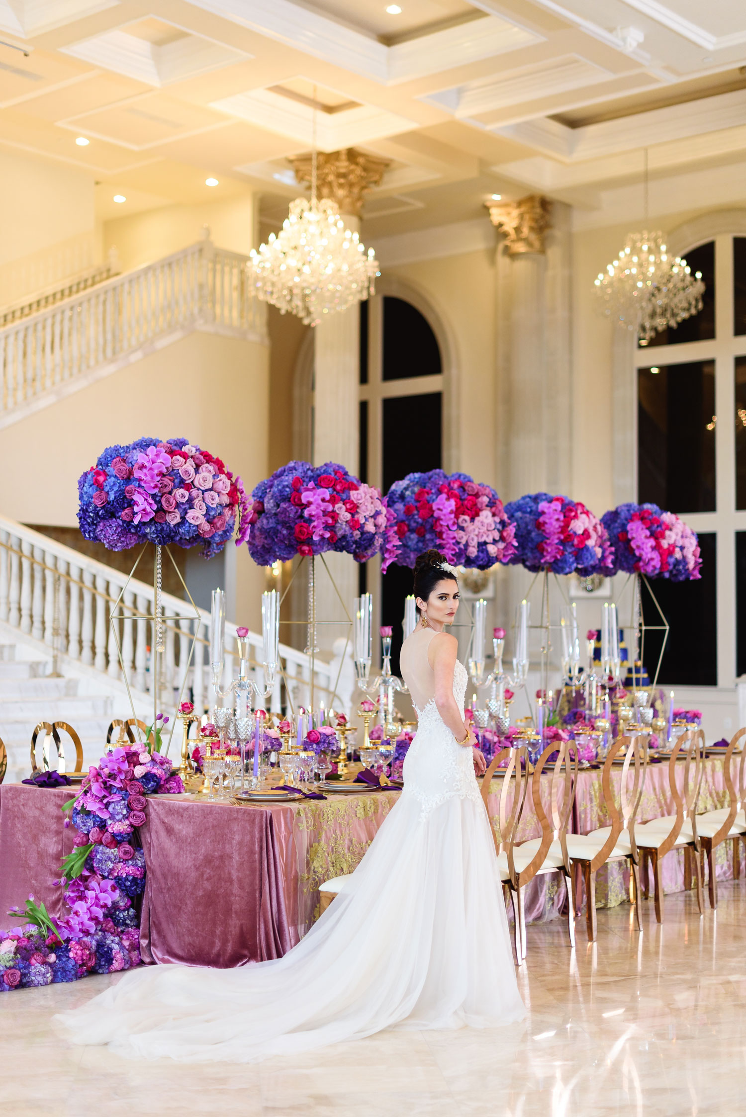 Styled shoot with bright purple color palette storybook setting Lily V Events king's table