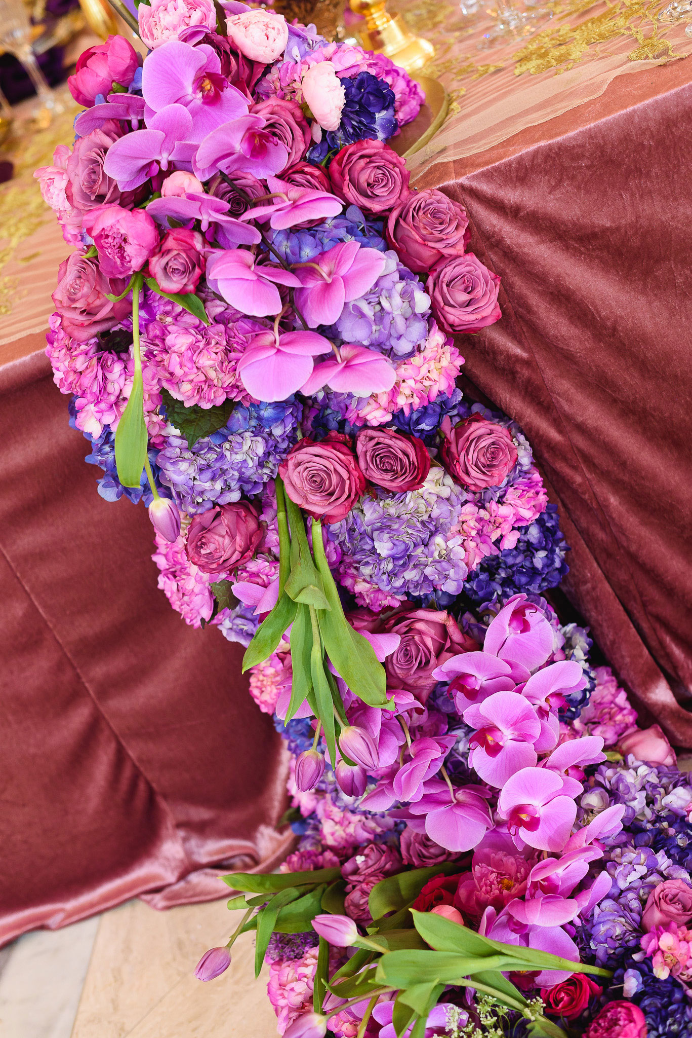 Styled shoot bold purple color palette Lily V Events lush flower runner