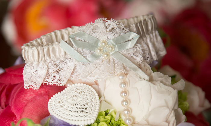 wedding garter with blue bow and string of pearls