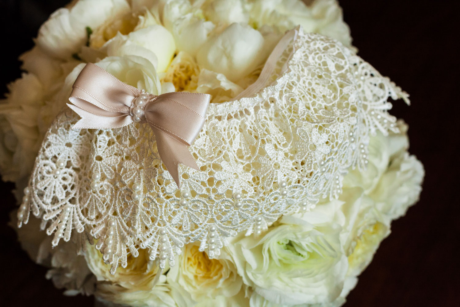 delicate lace garter with dusty rose bow and pearl beading
