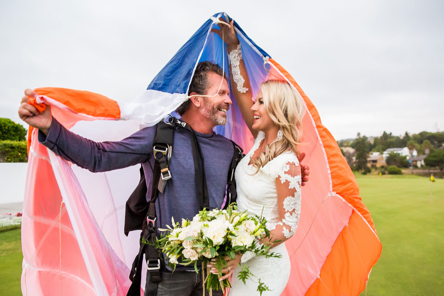 Navy SEAL Groom skydives into cocktail hour to surprise guests