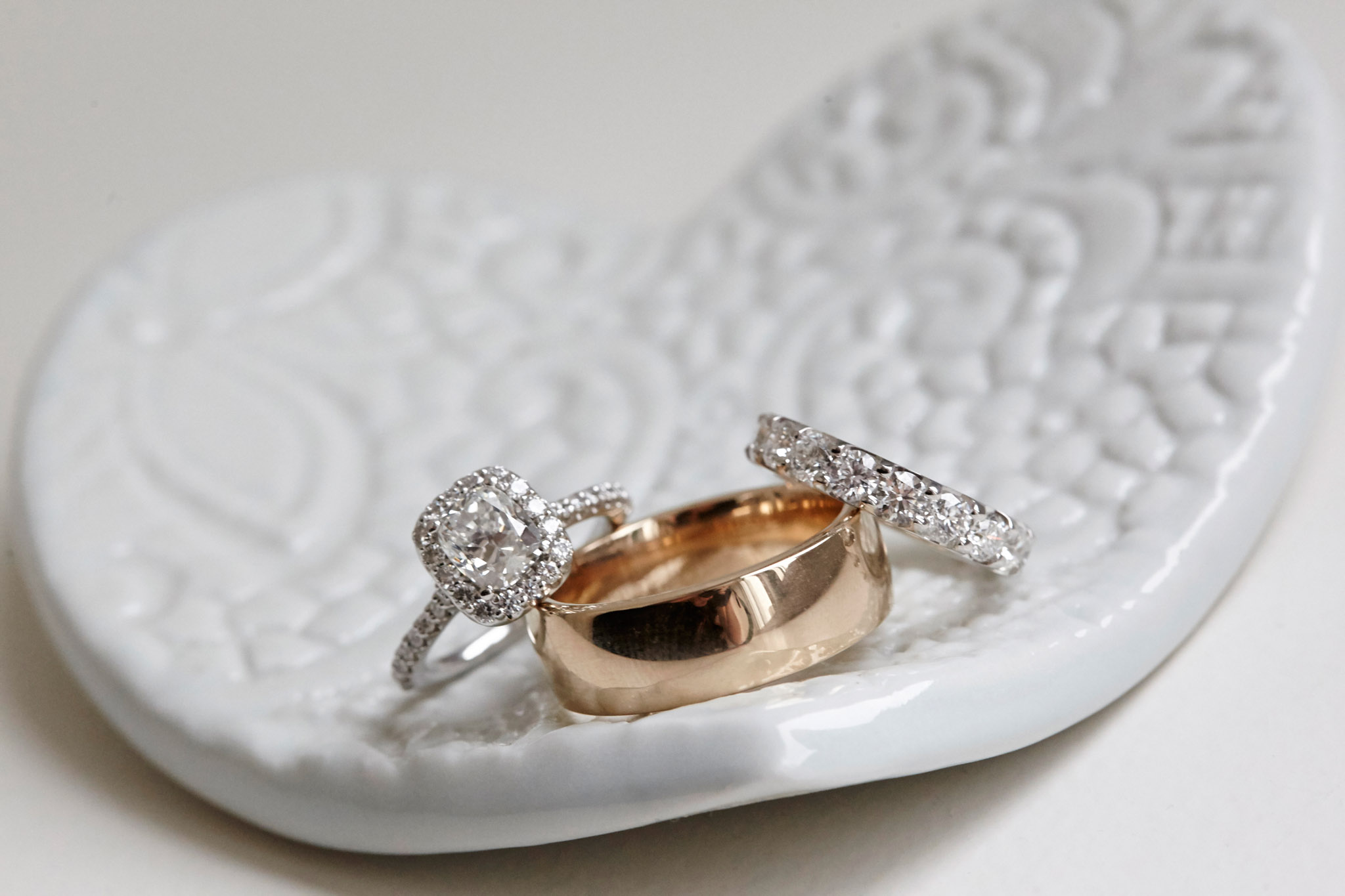 Up close photo of engagement ring and wedding rings wedding detail shot photography