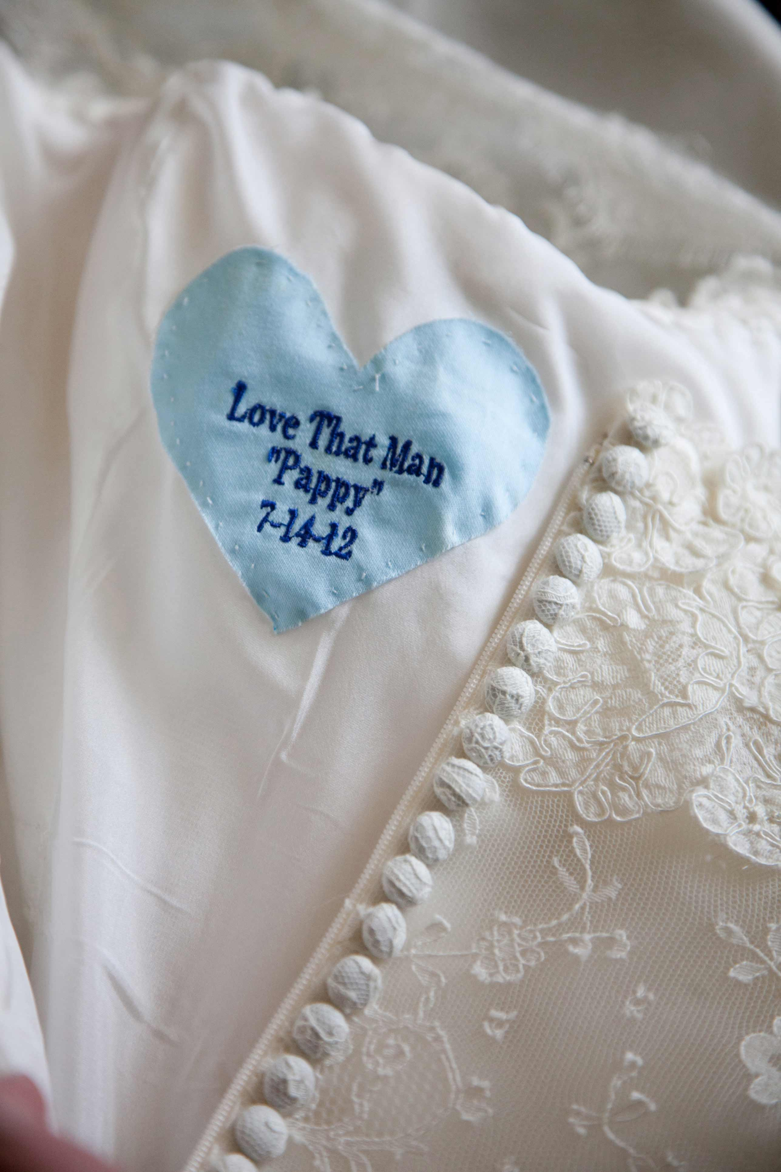 Something blue heart sewn into wedding dress wedding detail shot photography